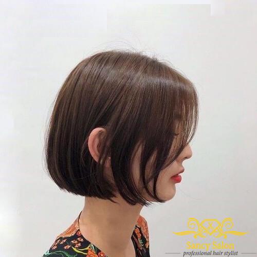 Kiểu tóc bob bằng có mái tỉa layer nhuộm nâu đỏ